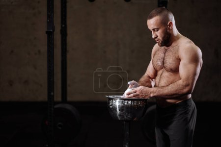 bodybuilder with white hands. useful thing for athlets. side view closeup photo