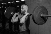 black and white photo. cross fit training with barbell