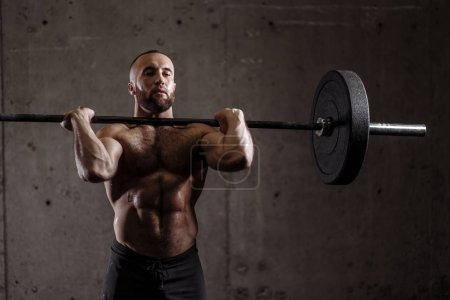 strong fit man preparing weightlifting contest