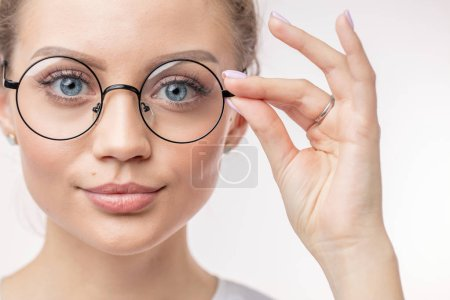 Photo for Modern glasses for students. sales on spectacles. glasses for far vision. girl with bad eyesight - Royalty Free Image