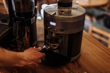man is going to brew fresh ground coffee