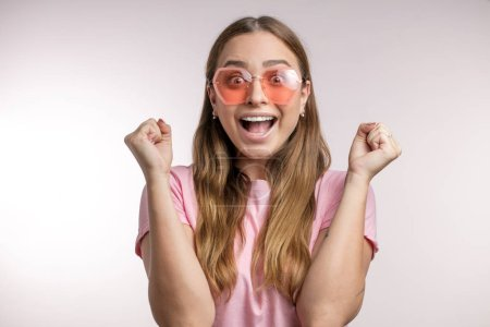 Photo for Happy energetic woman rejoicing her success and victory successful girl has achieved her aim and goals.emotions. feelings, expressions, happiness concept - Royalty Free Image