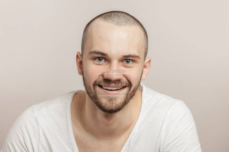 Photo for Emotional handsome fit man in good mood, close-up portrait. fortunate man in white T-shirt. glad fitness boy - Royalty Free Image