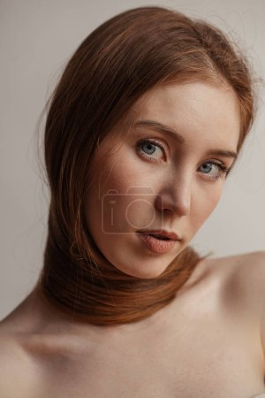 Woman with long thick straight hair tying around neck