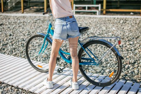Woman ride bike on the summer road, Activities for keeping healthy, recreation