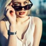 Outdoor summer time portrait of caucasian blonde w...