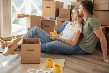 Couple moving new home. Happy people buy new apartment