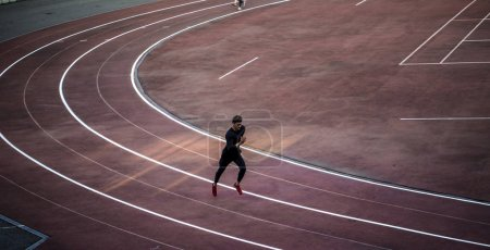 Photo for Top view of runner jogging on race track - Royalty Free Image