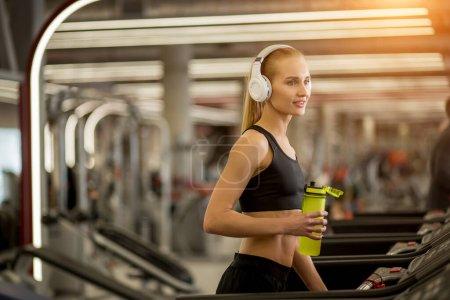 Attractive sports blonde women on running track. f...