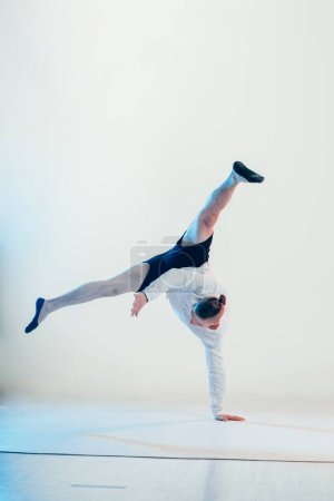Photo for Young hip hop dancer posing at studio. - Royalty Free Image
