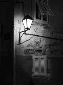 Street light on an old house in Cres (Croatia) after sunset