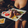Fast food: kebabs, fries and fresh salad in tray c...