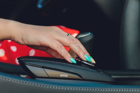 Photo for Close up of woman shifting gears on gearbox and driving car - Royalty Free Image