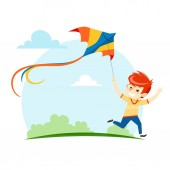 The boy runs and launches a kite into the sky