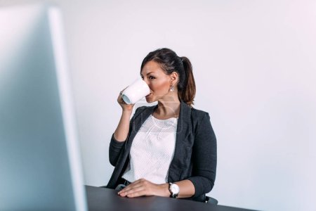 Businesswoman taking a break with cup