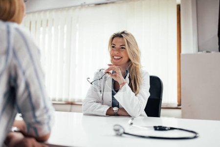 Portrait of a general practitioner talking with a patient.