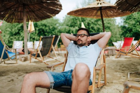 Man relaxing on a beach.