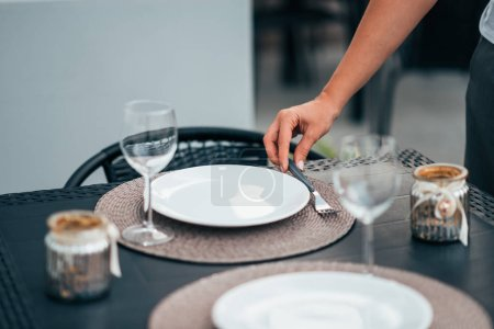 Photo for Setting the table for dinner. - Royalty Free Image