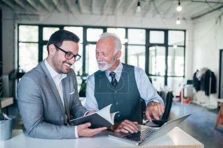Photo for Portrait of young and senior business men working together. - Royalty Free Image