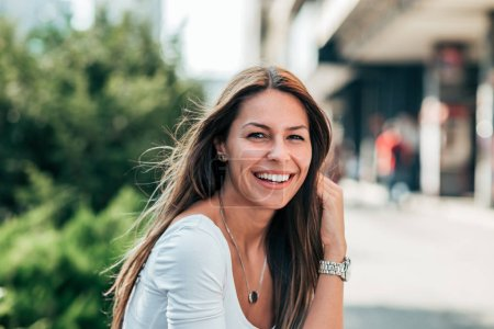 Photo for Portrait of gorgeous smiling young woman outdoors. - Royalty Free Image