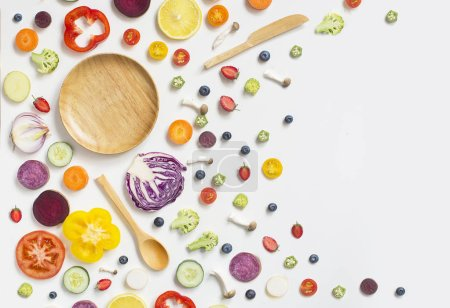 Photo for Colourful assorted raw vegan food sliced on white background. - Royalty Free Image