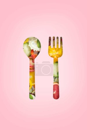 Photo for Conceptual vegan diet healthy eating conceptual image. See through fork and spoon paper cutting to various cut of vegetables and fruits. - Royalty Free Image