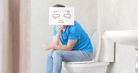 man with card  feeling  pain with constipation in toilet