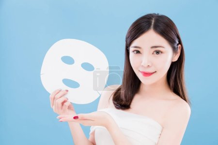 beauty skincare woman holding  mask on the blue background