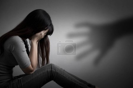 depressed  woman sitting  on the floor.  sexual harassment concept