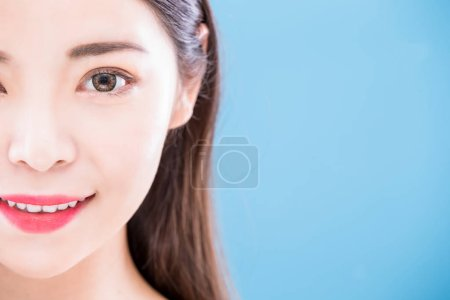 Photo for Beauty skincare woman  smiling  happily on the blue background - Royalty Free Image