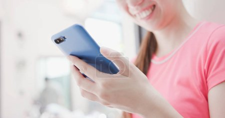 close up of woman using  phone internet shopping