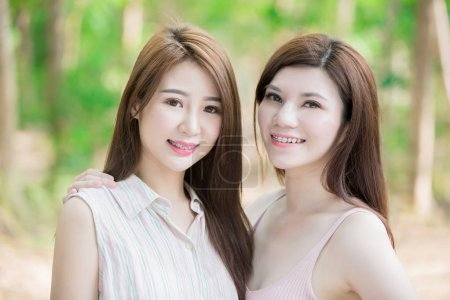 Photo for Two beauty women wearing  braces smiling - Royalty Free Image