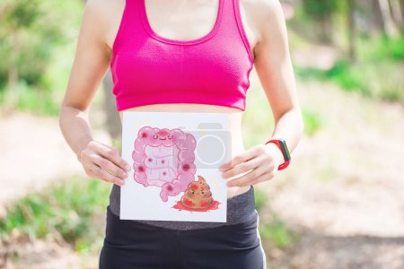 sport woman with  intestine board with green background