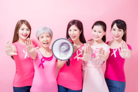 women showing stop  gestures.  breast cancer prevention on the pin background