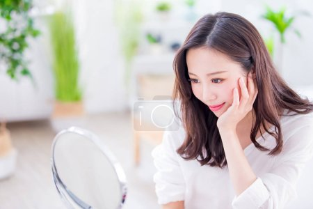 Photo for Beauty woman make up and look mirror at home - Royalty Free Image