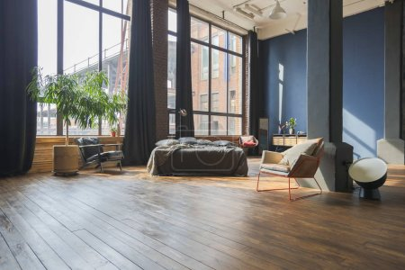 Photo for Modern interior design of studio apartment with wooden furniture - Royalty Free Image