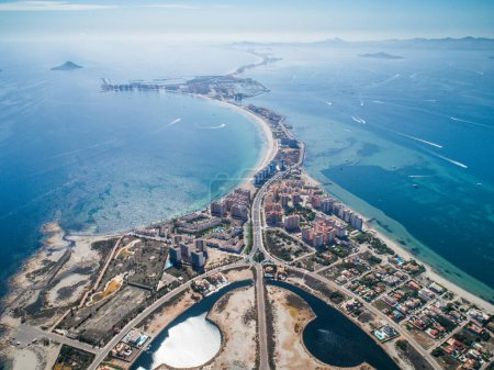 Photo for Aerial photo of buildings, villas and the beach on a natural spit of La Manga between the Mediterranean and the Mar Menor, Cartagena, Costa Blanca, Spain. 12 - Royalty Free Image