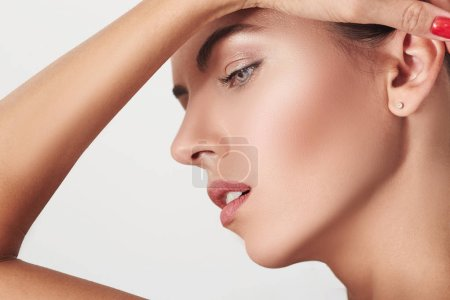 Beauty Woman face Portrait close-up. Beautiful Spa model Girl with Perfect Fresh Clean Skin. Female profile. Youth and Skin Care Concept.
