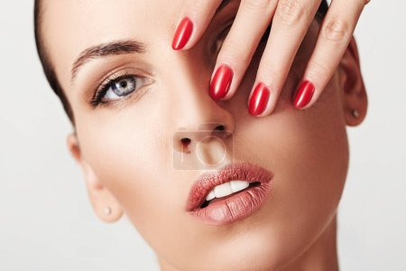Photo for Beauty Woman face Portrait. Beautiful Spa model Girl with Perfect Fresh Clean Skin and red manicure. Youth and Skin Care Concept. - Royalty Free Image