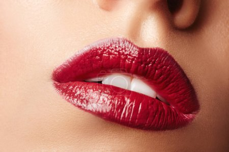 Lips make-up. Beauty high fashion trendy  red colour lips makeup sample, sexy mouth closeup. Lipstick. Professional Make up artist work