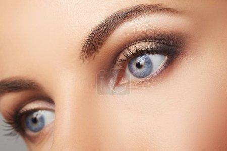 Beautiful human eyes close-up. Young Woman Blue eyes macro shoot. Macro Closeup eye