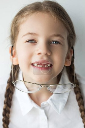 Photo for Little preschooler girl wearing glasses. Education, school. Smart kid - Royalty Free Image