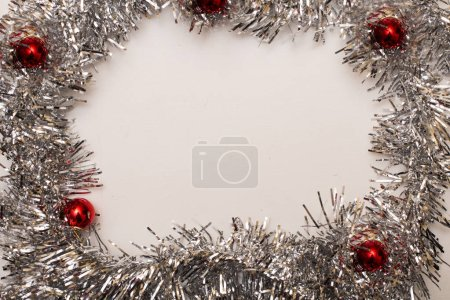 Photo for Christmas holiday card. Greeting poster with copy space. Silver decorative garland - Royalty Free Image