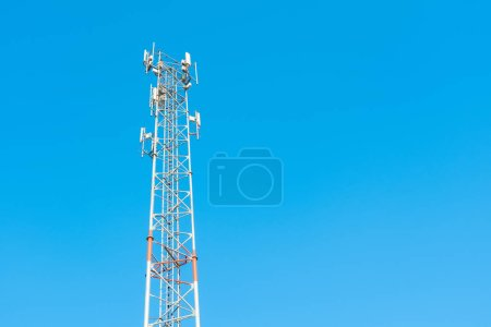 Antenna tower of telecommunication and signal repeater of mobile communication, wireless signal and radio with blue sky background.