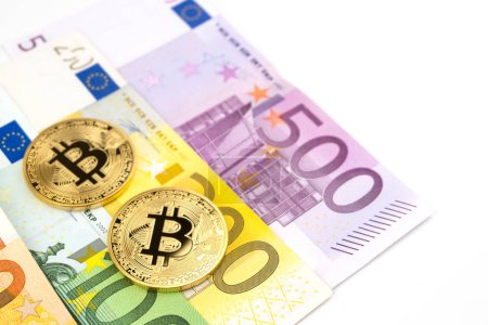 Golden bitcoin on pile of various euro banknote background. Cryptocurrency, Digital currency with euro money bills. Bitcoin exchange and accepted to payment in Europe, Finance and technology concept.