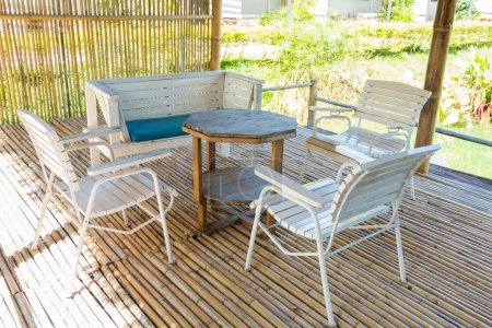Outdoor bamboo terrace and dining table in the morning sun.