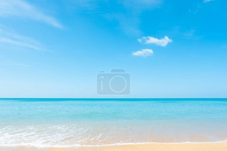 Beautiful white clouds on blue sky over calm sea background. Tranquil summer sea harmony of calm water surface. Sunny sky and tropical beach. Vibrant sea with clouds on horizon. Nature and outdoor.