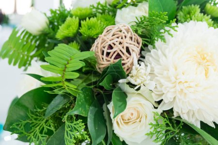 Beautiful and luxury white flowers decoration on wedding or dining table setting.