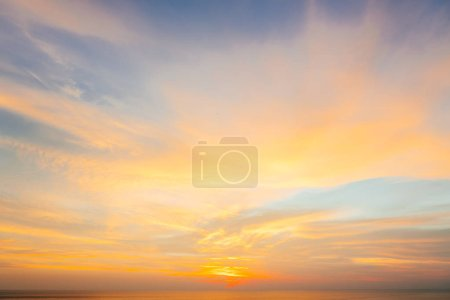 Sunset and sunrise golden sky. Amazing twilight sky after sunset for background. Colorful dramatic blue and orange sky in evening on summer season. Beautiful clouds, Majestic nature background.