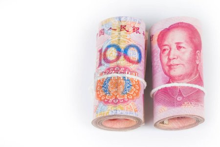 Rolls of one hundred chinese yuan banknotes with white robe band isolated on white background.
